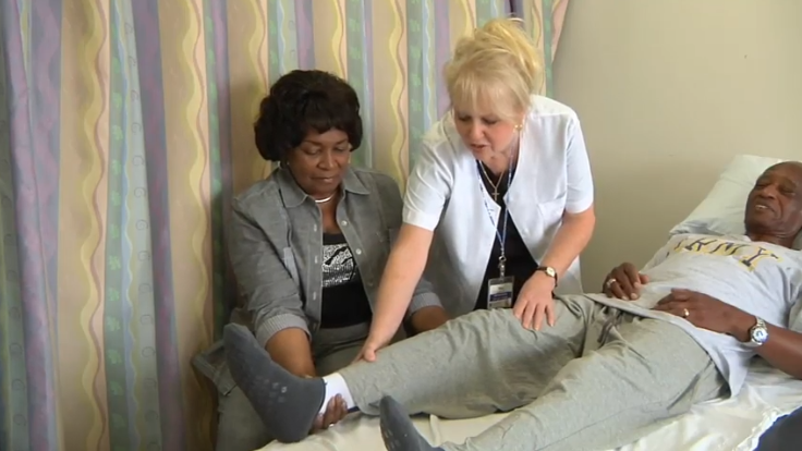nurse demonstrating how to move a joint replacement patient's limb