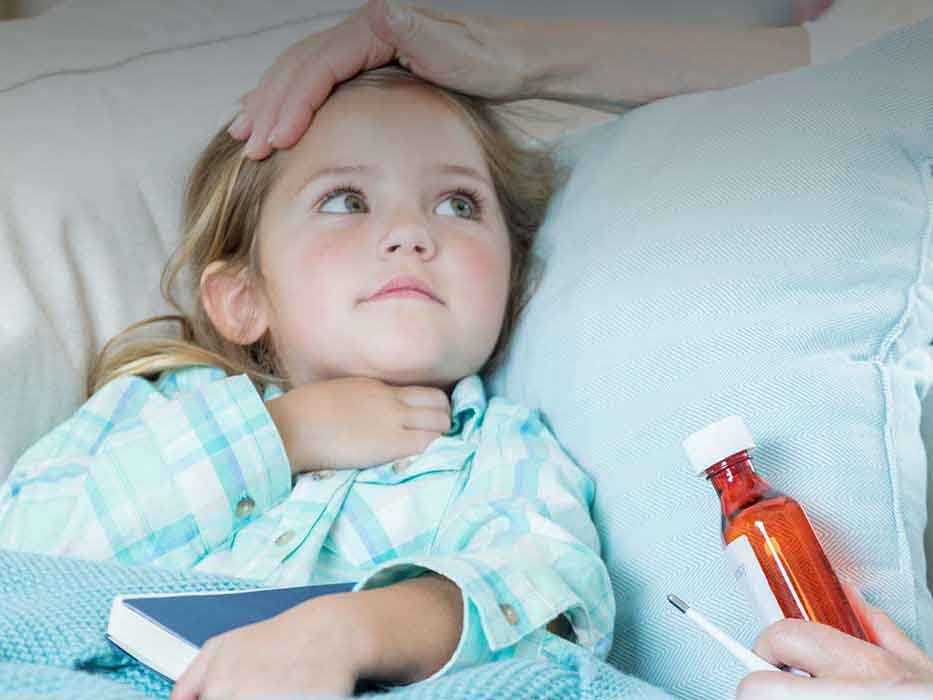 sick child being given medicine