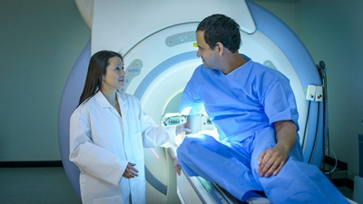 Patient MRI consultation with image technician