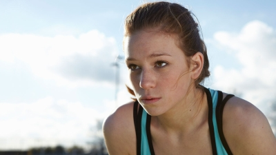 female athlete crouched and looking into the distance