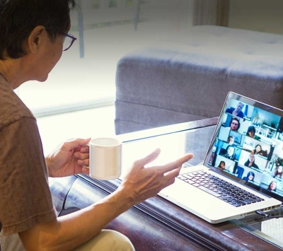 Mature man using virtual support group.