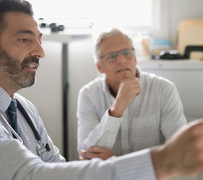 Doctor discussing with male patient