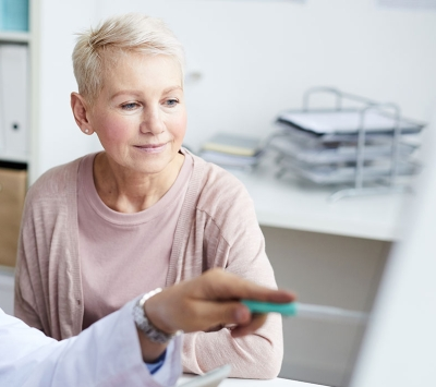 Mature female patient consulting doctor