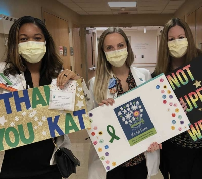 kidney team holding signs
