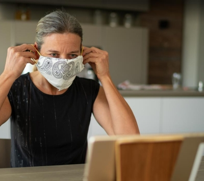 Mature woman putting on homemade mask
