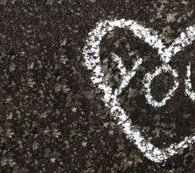 Street caulk drawing of heart and word you
