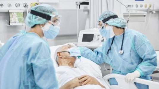 medical staff attending a COVID patient