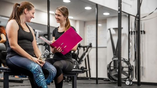 Health coach with client