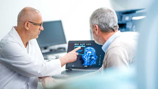 doctor sharing brain images with patient