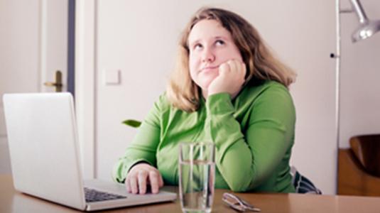 women on computer thinking