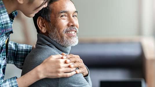 Comforting hand on shoulder