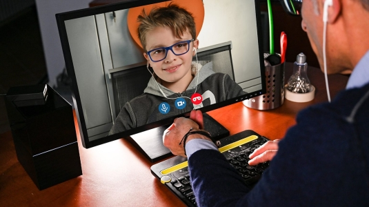 kid talking to doctor on video screen