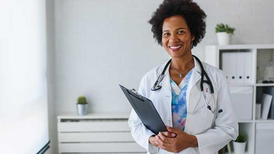 female Black doctor with a welcoming smile
