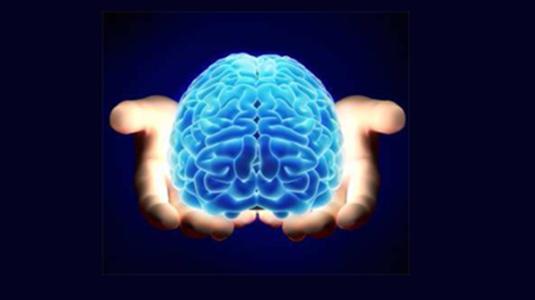 glowing brain in hands