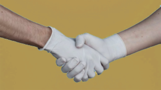 hands with rubber gloves in a handshake