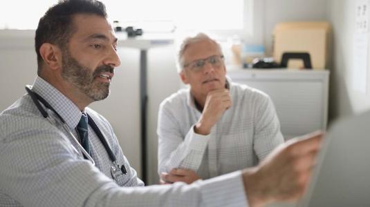 doctor advising patient