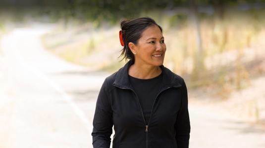 mature asian woman walking outdoors