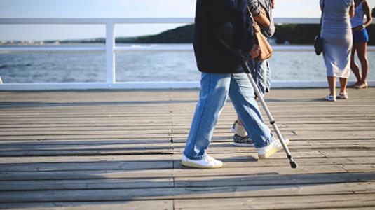 older couple walking on boardwalk