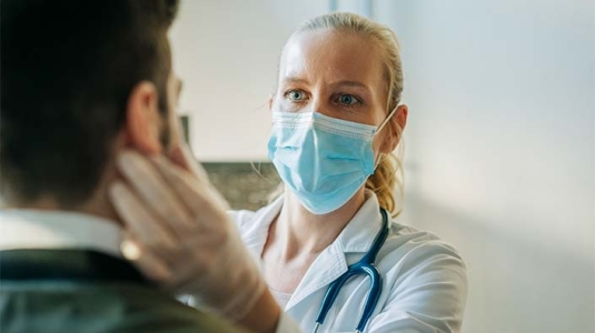 doctor checking patient for symptoms of respiratory illness