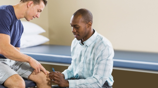 Inova Physical Rehab trainer with patient