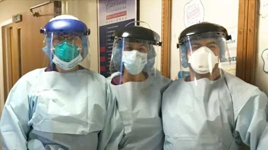 Healthcare team members in protective gear