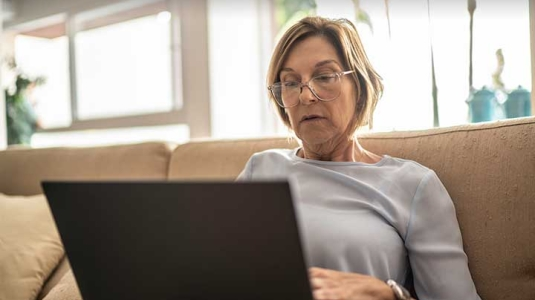 Mature woman on laptop at home