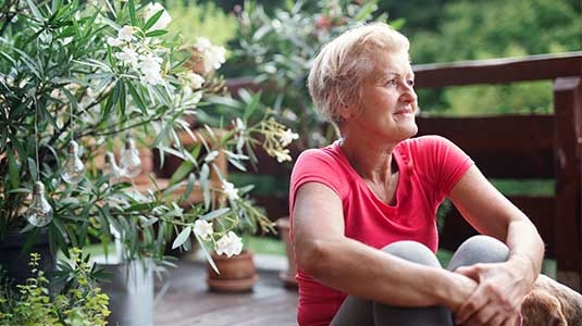 Mature woman meditative gaze.