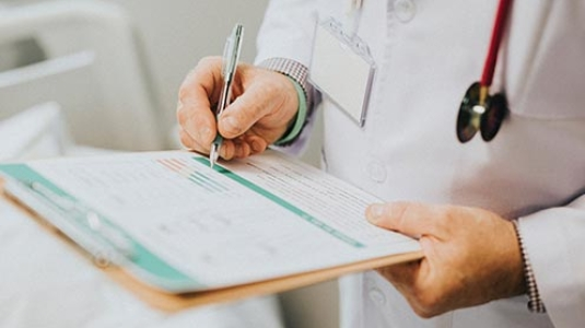doctor writing notes