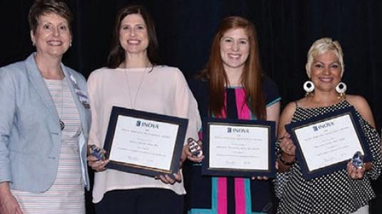 nurses posing with their awards
