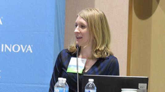 Clare Davidson speaking at symposium